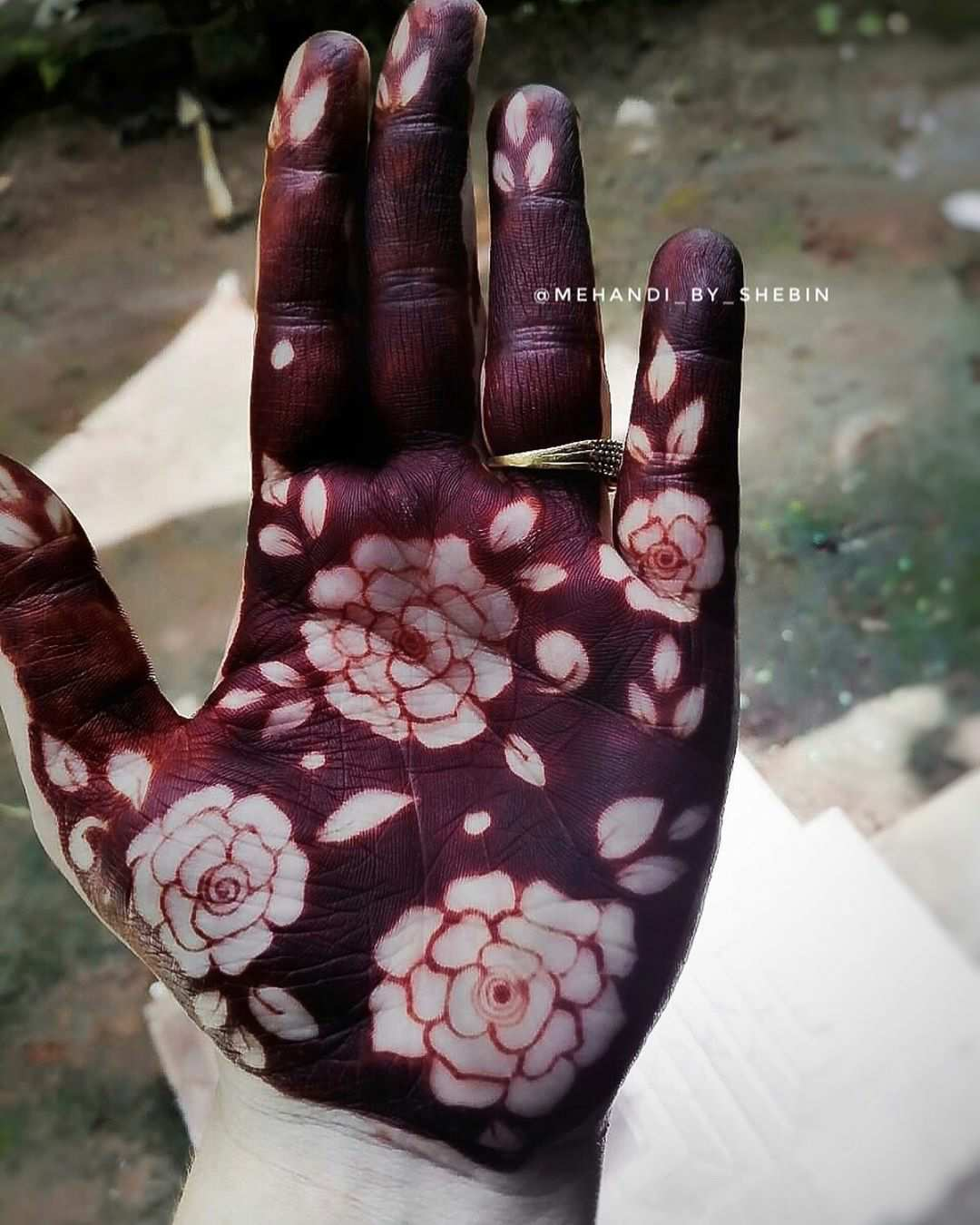 Negative Space Roses Mehndi Design