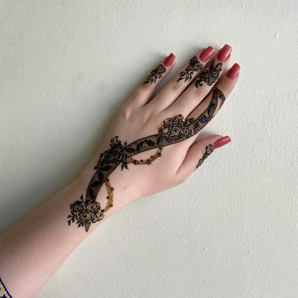 Minimal mehndi design for back of hand
